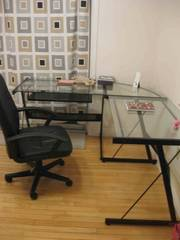 A BIG glass table with adjustable Chair for $130